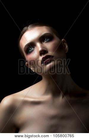 Attractive model with excess of makeup on her face