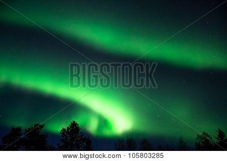 Green Aurora Borealis  On A Starry Sky