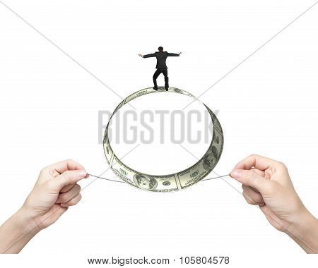 Two Hands Pulling Rope Businessman Balancing Roll Of Dollar Bills