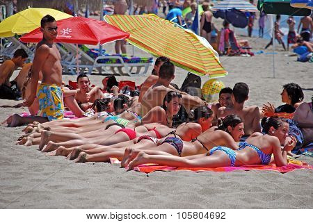 People sunbathing on Fuengirola beach.