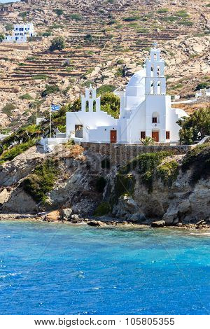 White church in the port of Ios-Island, Greece