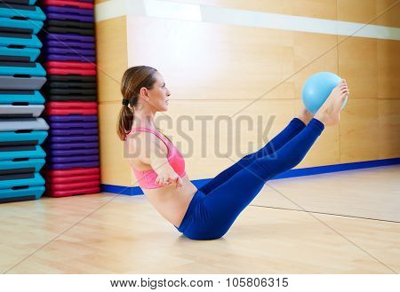 Pilates woman stability ball teaser exercise workout at gym indoor