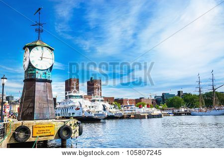 Clock on Aker Brygge dock, modern Oslo in Norway
