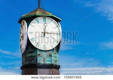 Famous clock on Aker Brygge, modern Oslo, Norway