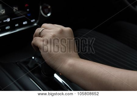 Woman Hand Holding Gear Stick