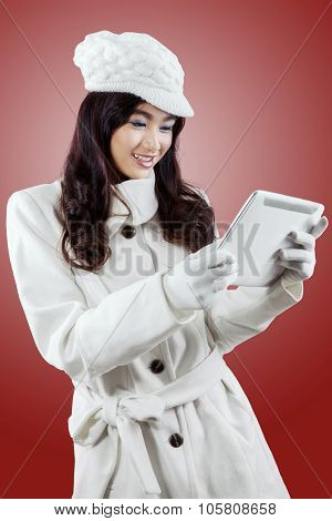 Girl Holding Tablet On Red Background
