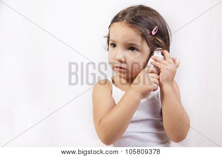 Little Girl With Electronic Thermometer