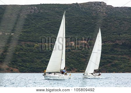 PYLOS, GREECE - CIRCA OCT, 2014: Sailboats participate in sailing regatta 12th Ellada Autumn 2014 among Greek island group in the Aegean Sea, in Cyclades and Argo-Saronic Gulf.