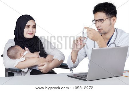 Male Doctor Prepare Injection To Give Vaccine