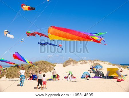 Fuerteventura - November 13: Viewers Watch From The Ground As Multicolored Kites Fill The Sky At 24T