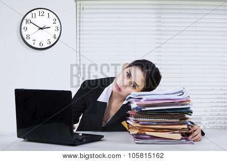 Stressed Woman With Laptop And Paperworks