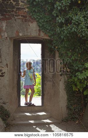 A Girl Stands In The Doorway