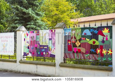 Metal Fence Decorated With Knitted Patterns With Animals