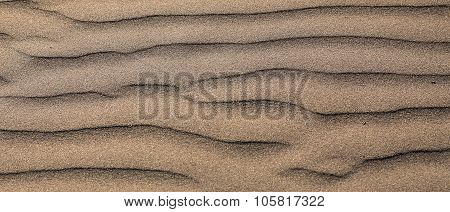 Waves of sand on the beach high contrast color gradient, background