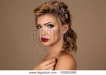 young woman with dark hair with bright makeup and luxurious headband