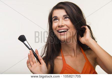 Lovely girl in orange shirt is smiling.