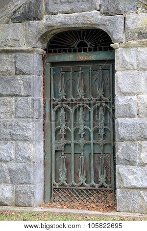 Detail of old metal door in stone structure