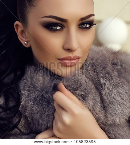 Gorgeous Woman With Long Dark Hair Wears Luxurious Fur Coat