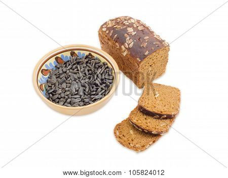 Brown Bread And Sunflower Seeds On A Light Background