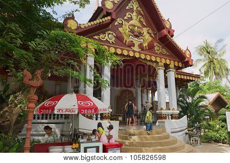 People visit Wat Khunaram temple in Koh Samui, Thailand.