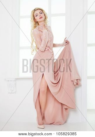 Portrait Of Young Beautiful Caucasian Blonde Girl In Gorgeous Dress