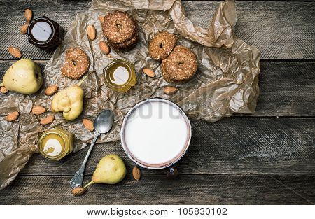 Tasty Pears Almonds Cookies And Joghurt On Rustic Wood
