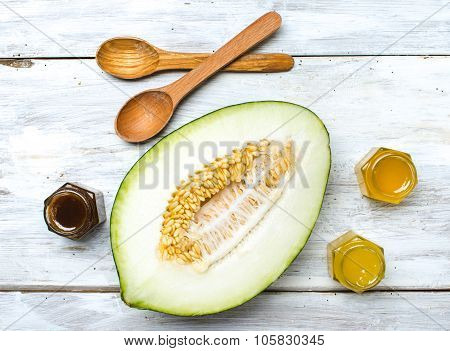 Healthy Melon With Honey On Rustic Board