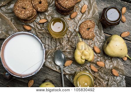 Pastry Pears And Yoghurt On Wooden Table