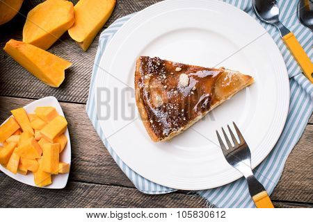 Piece Of Pie And Pumpkin Slices In Rustic Style