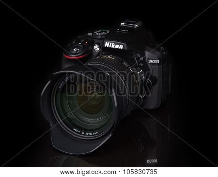 Kyiv, Ukraine - June 19, 2015: Nikon D5300 Camera With Sigma 17-50Mm F2.8 Lens On Black Background