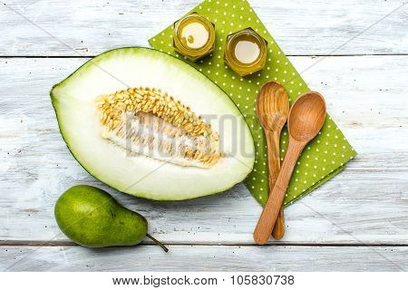 Ripe Melon Honey And Pear On White Wood