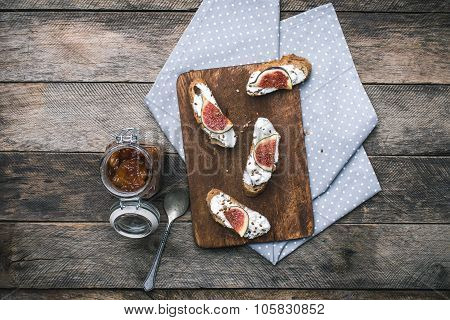 Rustic Style Bruschetta Snack With Jam And Figs On Napkin