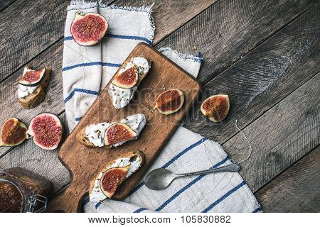 Rustic Style Bruschetta Snacks With Cheese And Figs