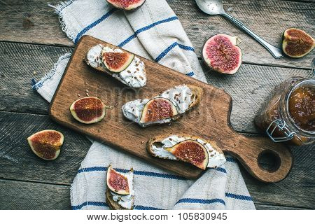 Rustic Style Healthy Snacks With Cut Figs On Napkin