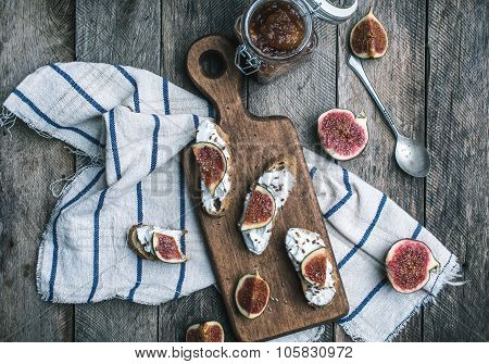 Rustic Style Tasty Bruschetta With Jam And Figs On Napkin