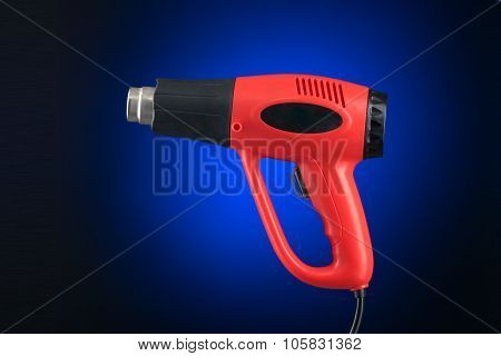 Heat Gun With Sticker Isolated On Blue Background