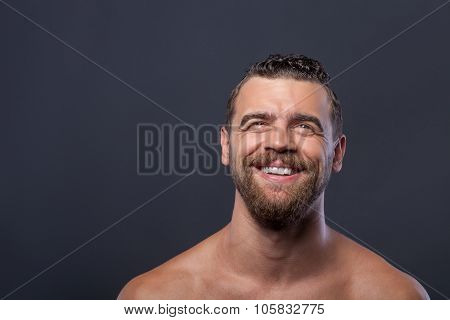 Attractive young bare guy with beard laughing