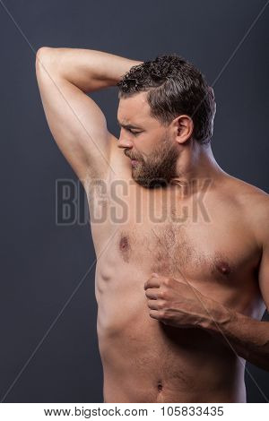 Attractive bare guy with beard in the morning