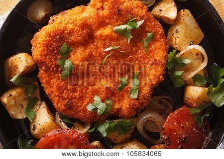 Weiner Schnitzel, Fried Potatoes In A Pan Closeup. Horizontal Top View
