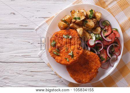 Breaded German Weiner Schnitzel With Potatoes. Horizontal Top View