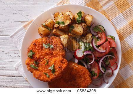 German Weiner Schnitzel With Potatoes Closeup. Horizontal Top View