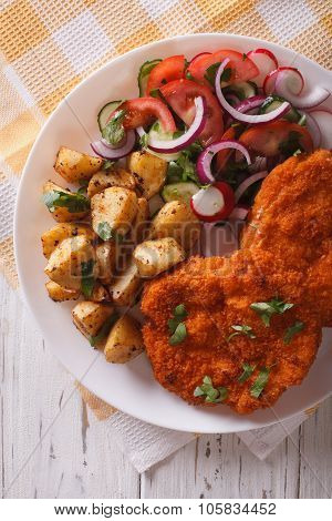 German Weiner Schnitzel With Potatoes Closeup. Vertical Top View