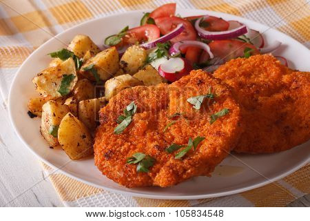 Wiener Schnitzel, Fried Potatoes And Vegetable Salad Closeup. Horizontal