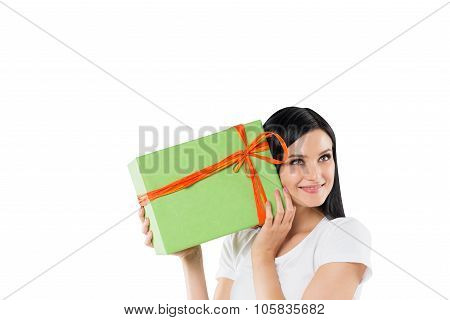 A Smiling Brunette Is Holding A Green Gift Box. Isolated On White Background.