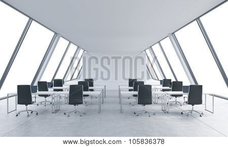 Workplaces In A Bright Modern Open Space Loft Office. White Tables And Black Chairs. White Copy Spac