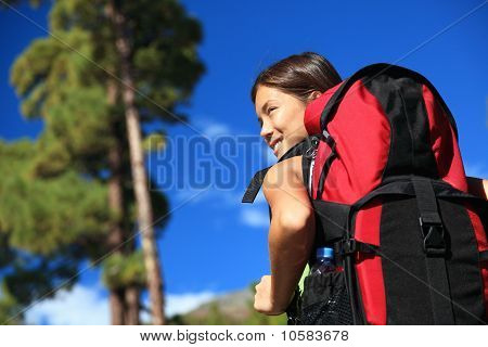 Woman Hiking Looking At View