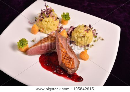 Duck Breast With Berry Sauce And A Risotto With Red Onion Sprouts, Menu In Restaurant