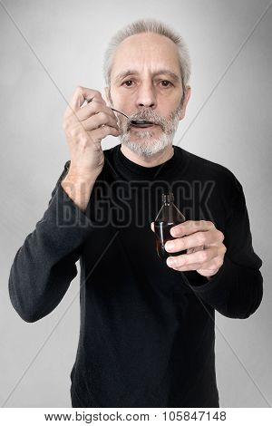Man Drinking Cough Syrup
