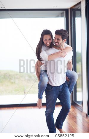 happy young romantic couple have fun relax smile at modern home livingroom interior