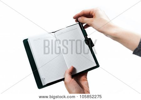 Turning over pages of notepad. Isolated on white background